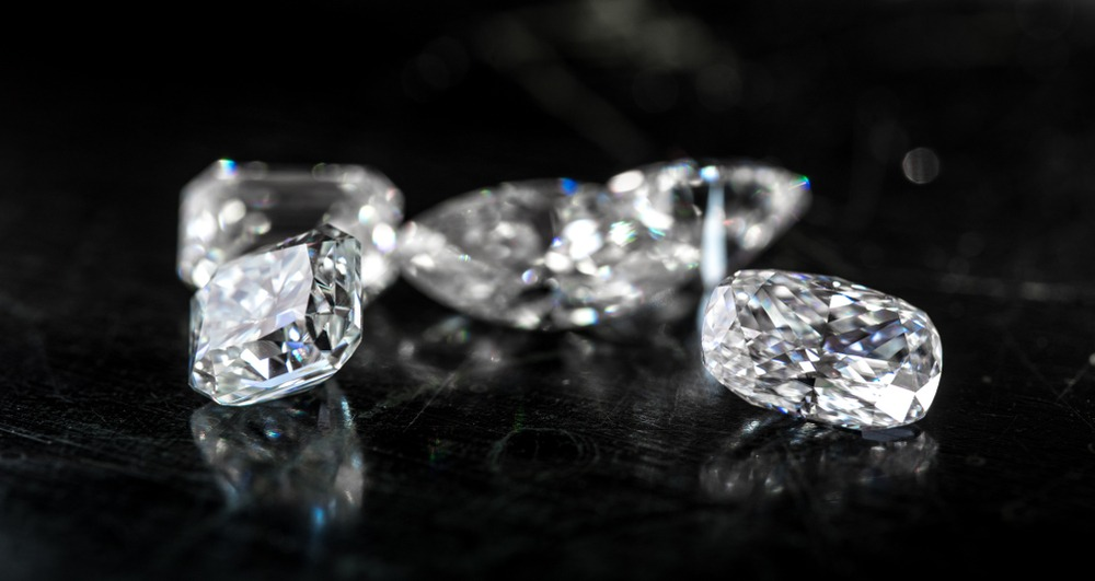 Various cuts of diamond on a black background